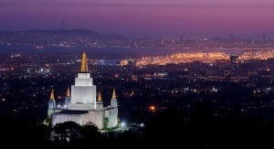 Night photo of the Mormon temple in Oakland, California at night, overlooking the city.